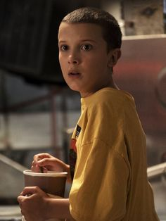 Image result for eleven stranger things yellow shirt