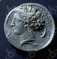 Tetradrachm (four drachma) coin with the head of Arethusa, the patron nymph of Syracuse. Country of Origin: Italy. Period/ Date: 405 - 400 BC. Place of Origin: Syracuse.