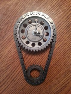 Hey, I found this really awesome Etsy listing at https://www.etsy.com/listing/182704716/automotive-timing-gear-set-wall-clock