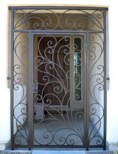 Scrollwork Entryway Gallery All - Artistic Iron Works - Ornamental Wrought Iron Specialists Wrought Iron Security Doors, Security Gates, Wrought Iron Stairs, Wrought Iron Decor, Door Grill, Grill Door Design, Gate Design, Entry Gates, Entrance Doors