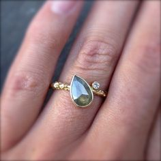 rose cut pear diamond - except not rose cut and clear stone. LOVE how it's tilted!!!