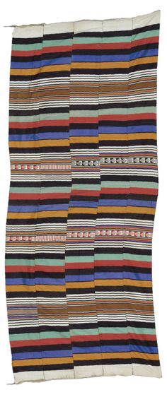 Africa | Large blanket from the Ivory Coast | Cotton; woven in strips with bright bands of colour and geometric motifs