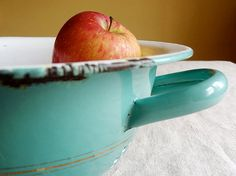 vintage enamelware colander in a lovely turquoise color with gold pin stripes. Available at AtticAntics, $34.50