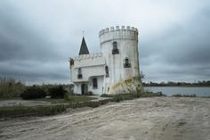This castle outside of New Orleans was built as a tourist attraction in 1991 but no one ever came. Nevertheless, it is one of the only buildings on the coast to have survived the full force of Katrina Lost Highway, New Orleans Travel, Timeless Design, Road Trip, Coast, Survival, Photography, Small Houses, Attraction