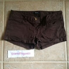 Brown shorts Dark brown shorts from Express. Size 0. Selling because they are too small on me. Willing to take offers Express Shorts