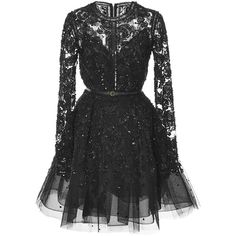 This long sleeve Elie Saab dress features a tulle construction with full beaded embroidery in a floral motif, a rounded neck, and a flounced mini skirt. Expose…