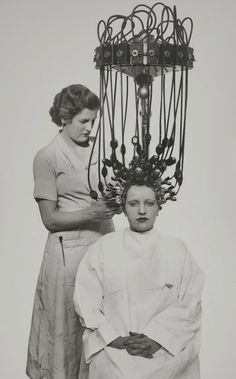 Gallic hair-dryer ,1935 By the time this contraption had been put in place...the hair would have dried naturally! :)