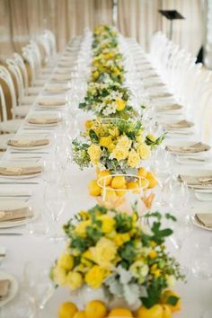 Literally using some citrus along the long table... with some roses, dusty miller and green foliage.