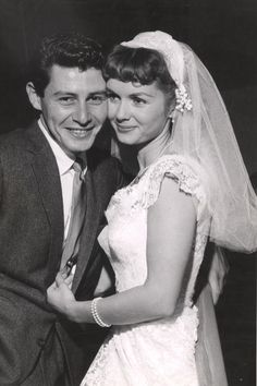 Debbie Reynolds - The Most Iconic Wedding Dresses of All Time - Southernliving. Wed Eddie Fisher in September 1955  Reynolds wore a lace gown with cap sleeves. A short veil and pearl jewelry completed the young star's look.