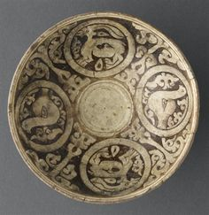 Bowl with medallions  12th-13th century  Northeast Iran Earthenware, champlevé and incised underglaze slip decoration, transparent glaze