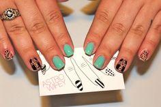 Minty green and cheetah crosses nail art