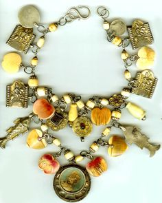 By Linda Pastorino | Ivory charm necklace; antique ivory, gilt charms , photo pendant, Indian beaded chain.  All charms are from the 19th century