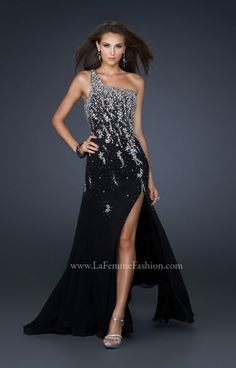 This one shoulder strap looks like you could run straight off the the Prom red carpet! The strap and bust area is complete embellished with fabulous shining and sparkling rhinestones and sequins that almost compete the look! The La Femme 17706 is absolutely stunning for Prom, and the detailing and mid thigh slit create an overall prom girl look perfectly! Pair this with silver jewelry for pulled together style!