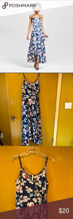 Blue floral dress It is a breathable 100% polyester blue floral wrap dress. Spaghetti strap.  And have a breast button for more modest wear. Xhilaration Dresses Maxi