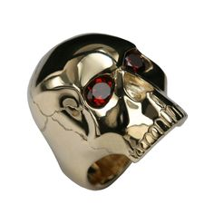 Design: Stephen Einhorn Skull Ring in Yellow Gold with Garnet Eyes... Designer Einhorn's Skull ring is one of his hero pieces, a statement design with a rock 'n' roll spirit. Wear this ring if you are up for a Mercury or Ivor Novello award. What, you've already been? You didn't invite The Horn? Shame on you!