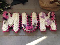 Funeral Flowers. Mum funeral flower letters, flowers for mums funeral, pink and white funeral flowers, butterflies www.thefloralartstudio.co.uk