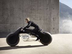 BMW sees motorcycles of the future equipped with self-balancing tech and glasses with heads-up displays.