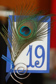 Peacock & Sapphire Blue Theme Table Number. One way to incorporate the peacock feather with a different color of blue and purple(or lime green)