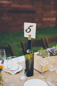wine bottle table number ideas http://www.weddingchicks.com/2013/09/24/natural-chic-wedding/