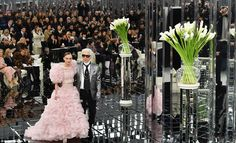 Mirrorball: The extravagant runway set up included a beautiful mirrored catwalk and glass ...