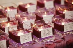 Sara, cool idea for place cards..maybe using orangey glass beads in the votive..doubles as a favor