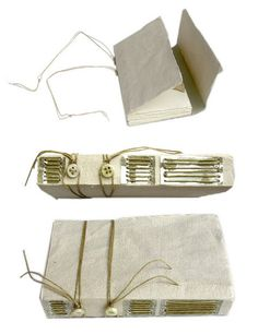 2 Button Longstitch by Annie Fain Liden. Heavy lavender/cream cover paper, mica panels on spine that stitching goes through, 2 button closure on spine, longstitch binding
