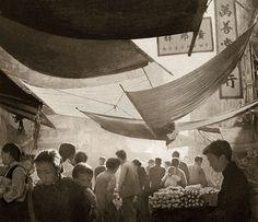 Tarps above a wet market. By Fan Ho, Hong Kong, 1950s.