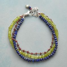 "EYE OF THE PEACOCK BRACELET -- Lime green peridot convenes with red garnet and the beguiling blue of lapis and sapphire, exotically elegant and casually cool. Sterling silver lobster clasp. USA. Exclusive. 7-1/2""L."