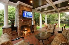 The perfect backyard patio: ceiling fans, gorgeous ceiling, outdoor fireplace, & flatscreen