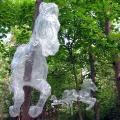 Mark Jenkins creates sculptures made out of packing tape and then places them in real-world contexts. (includes video of how it's done)
