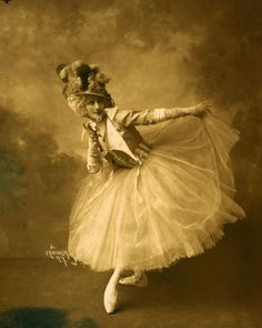 Anna Pavlova posed in costume for her ballet Rondino, possibly performed by her company in 1914. Photographs by Mishkin.