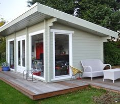 Stunning garden office with decking, meeting room, bar and chill out area. This garden office has a very subtle colour scheme, with pale grey/green walls and white washed edging. Backyard Office, Backyard Studio, Backyard Sheds, Garden Studio, Garden Office, Backyard Storage, Garden Cabins, Small Garden Cabin, 20 M2