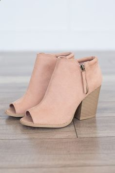 Faux suede peep toe bootie featuring a side zipper detail and a chunky stacked heel. Man made material. Heel measures 3.5 tall. Fits true to size. Style #SBARNES-102ABLUSH