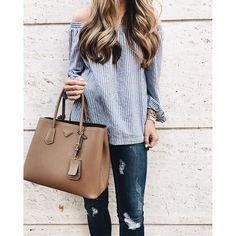 Off shoulder striped top, ripped skinny jeans and tan Prada bag