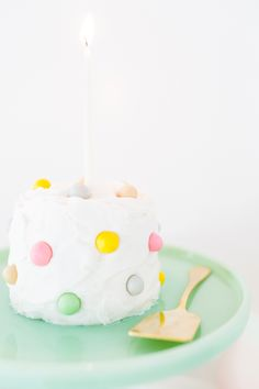 DIY Pastel Pom-Pom Cake.Supplies: • Edible decorating dough or fondant • Gel food coloring • Toothpicks (one for each color) Visit site  for the steps.