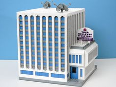 """""""Taco Bellevue Hospital"""" LEGO Model by Matt De Lanoy.  While based on a building in a Futurama TV Show episode, this recreation is a Brutalist design if you interpret the white detailing as concrete."""