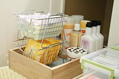Organizing Under the Bathroom Sink - pull out drawers and baskets/tupperware.