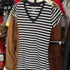 Women's top Stripped black&white top. Excellent condition. V neck front. Material is 95% cotton, 5% spandex. Wet Seal Tops