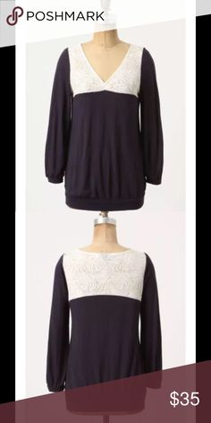 """Anthro Postmark Loulou Top Blue Ivory Lace $88 Anthropologie Postmark Loulou Top Blue Knit Blouse Ivory Lace Modal Sz XS  Size: XS   ~Dark navy, with ivory lace at the neckline ~Stretchy band at the bottom of the blouse ~3/4 sleeves Ivory lace takes the plunge in this casual V-neck pairing of modal and wool.  Fabric: 70% modal/30% wool. Hand wash.  Measurements are approximate and taken laid flat: Bust- 16"""" across Bottom- 14"""" across, stretching to 19"""" Length- 24"""" from top of shoulder to hem…"""