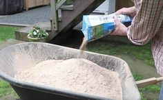 Presprout your grass seed. Mix with sawdust, keep wet until it sprouts, add topsoil, spread on lawn.