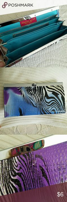 NWOT wallet clutch Pretty pretty zebra print wallet , credit card slots,  mini change compartment ( decorative ) Never used Depeche mode Accessories