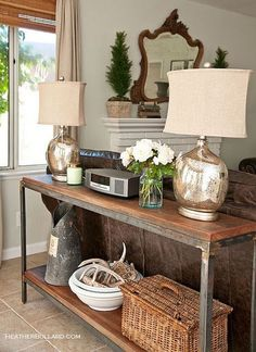Treat the back of your couch to some style! Set up a console table with two table lamps to offer more lighting and visual appeal.