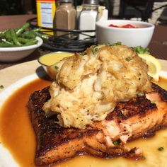 Salmon with Jerk Blackening topped with a Mini Crab Bomb and a Butter Sauce and as sides we ordered String Beans and a Baked Potato!