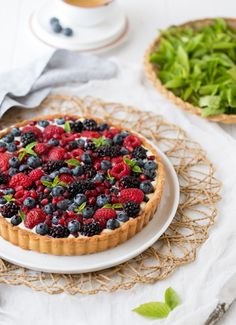 A classic summer dessert recipe: Summer Berry Tart. With a delicious pastry cream and a tart shell, this tart is the best way to use summer berries in abundance. Summer Dessert Recipes, Delicious Desserts, Yummy Food, Berry Tart, Fruit Tart, Pavlova, Chutney, Tart Recipes, Cooking Recipes