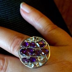 Purple & green amethyst ring - Sterling setting Beautiful purple and palest shade of green (both amethyst) stones. This fits me comfortably and I wear a size 8 ring. May work for a 7.5, but only if you flux between a 7.5 and 8. Setting is solid sterling, .925 stamped (no overlay - solid). Makes for a beautiful cocktail ring. Jewelry Rings