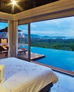 The villas have a modern tropical look, with neutral colors and views of the Andaman Sea. The Pavilions, Phuket, Thailand.