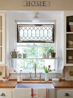 Easy interest added by hanging a window within a window, and the little shelf makes a great spot for herb pots.