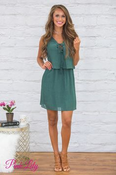 Explore the world in style with this gorgeous dress! Featuring a beautiful shade of forest green paired with a soft, slightly textured material, this dress is lightweight enough to handle warm days while still looking beautiful on cooler days!