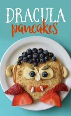 Imagine the delight your kids will have on their faces when they see a plate of Halloween Pancakes waiting for them tomorrow morning. Topped with fresh fruit for the faces, this breakfast treat will make your entire family happy. Comida De Halloween Ideas, Fete Halloween, Halloween Food For Party, Spooky Halloween, Halloween Treats, Girl Halloween, Halloween Halloween, Halloween Finger Foods, Halloween Dishes