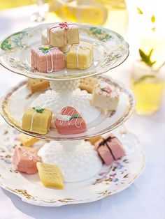 Create a three-tier stand for serving nibbles with a pair of candleholders and china plates.